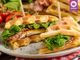 Waffles sandwich with chicken and fresh salad